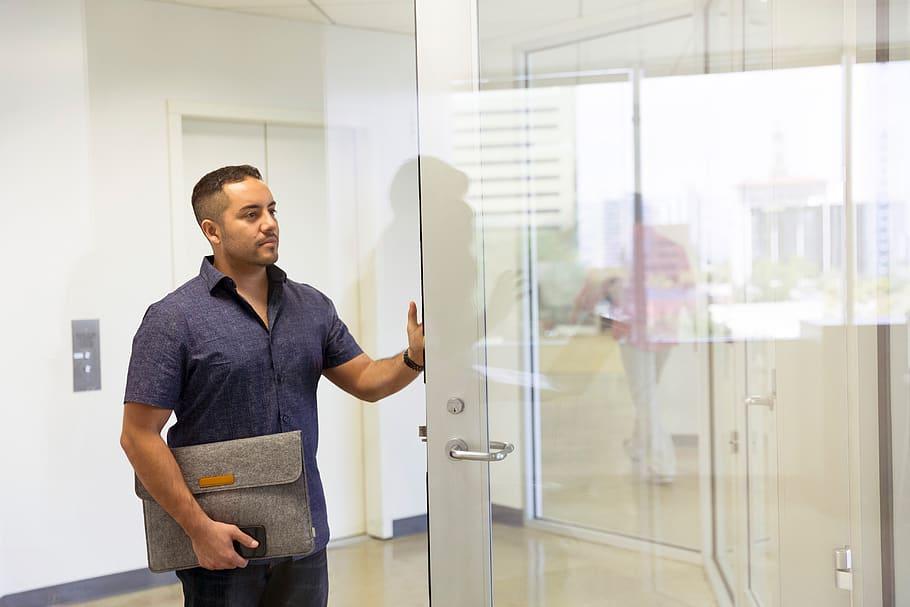 man-entering-conference-office-desk-people